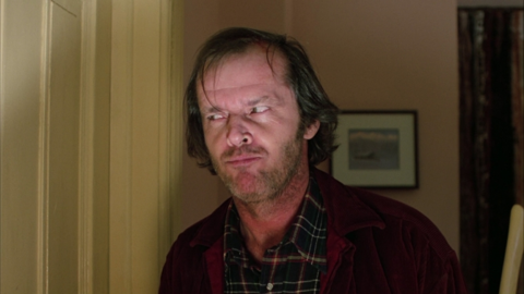 Jack Torrance knocking on a hotel door