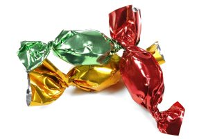 Gifts can be packed creatively by imitating a hard candy wrapper.