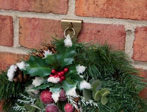 A clip to hang a wreath on a brick wall.