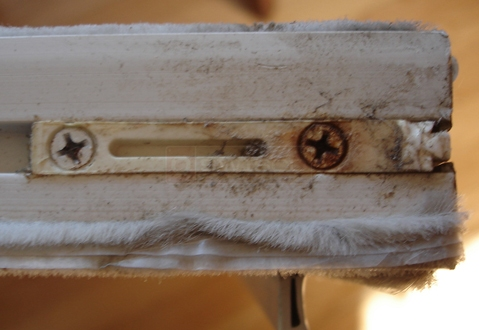 A customer submitted photo of a broken window latch.