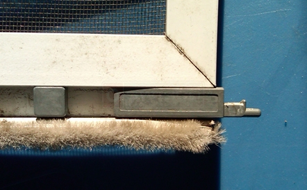 A customer submitted photo of a screen door side bolt.