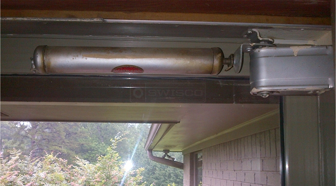 A customer submitted photo of a storm door closer.