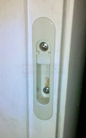 A customer submitted photo of a screen door part.