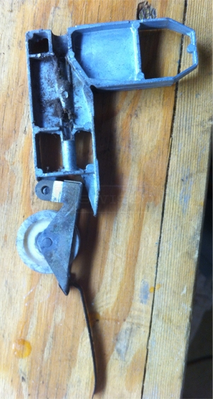 A customer submitted photo of a screen door roller.