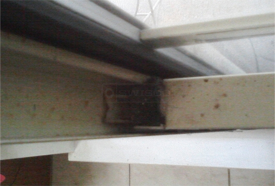 A customer submitted photo of a window sash.