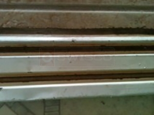 User submitted a photo of a mirror closet door track.