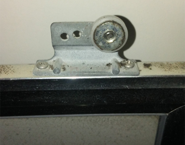 User submitted a photo of a shower door roller.